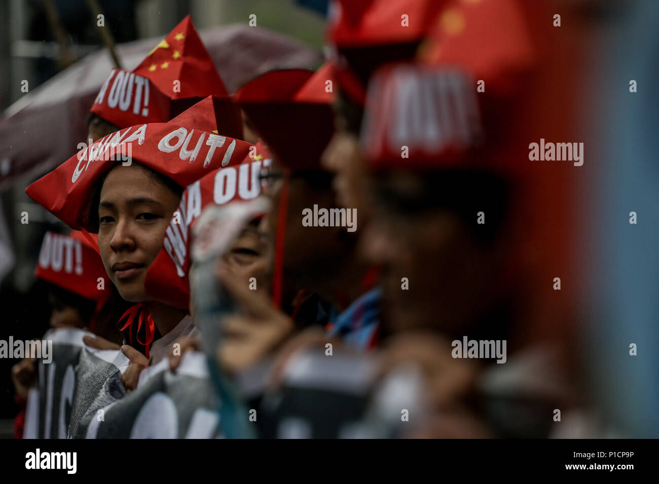Manila, Philippines. 12th June, 2018. Various militant groups protest in front of the Chinese consulate in Makati City, Philippines in celebration of the 120th Philippine Independence Day on Tuesday. June 12, 2018. The groups condemn the ongoing dispute between the Philippines and China in the South China Sea. Credit: Basilio H. Sepe/ZUMA Wire/Alamy Live News - Stock Image