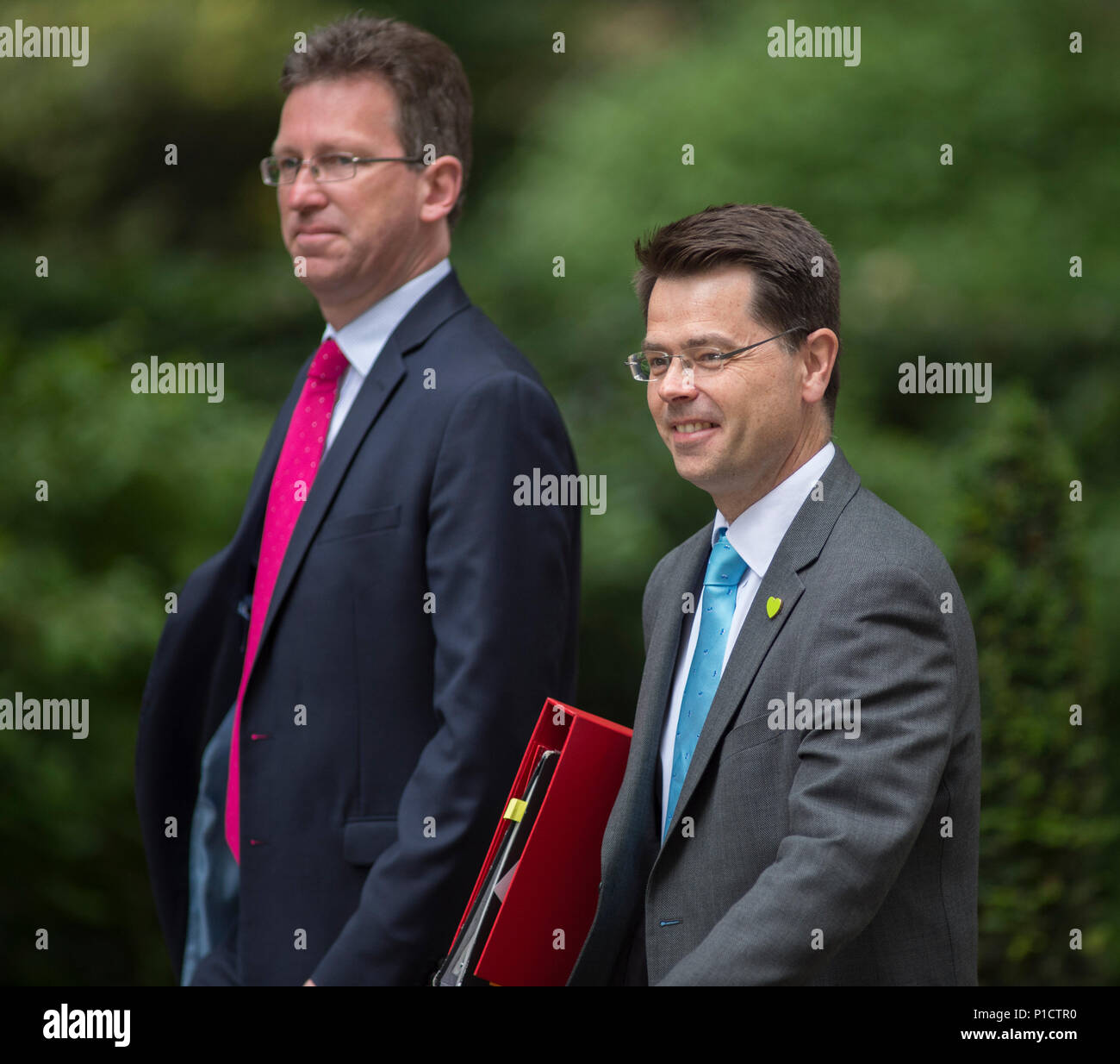 Downing Street, London, UK. 12 June 2018. Jeremy Wright QC, Attorney General in Downing Street for weekly cabinet meeting, arriving with James Brokenshire, Secretary of State for Housing, Communities and Local Government wearing a Grenfell Green Lapel Badge. Credit: Malcolm Park/Alamy Live News. Stock Photo
