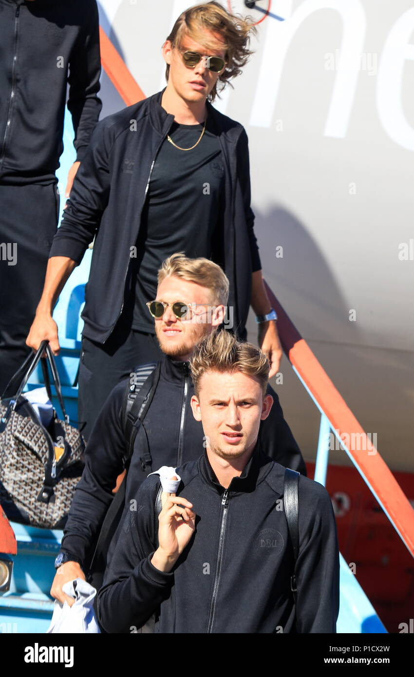 KRASNODAR TERRITORY, RUSSIA - JUNE 11, 2018: Jannik Verstergaard, Nicolai Jorgensen and goalkeeper Frederik Ronnow (back to front) of the Danish national football team welcomed at Anapa Airport ahead of the 2018 FIFA World Cup scheduled to start on June 14. Valery Matytsin/TASS - Stock Image
