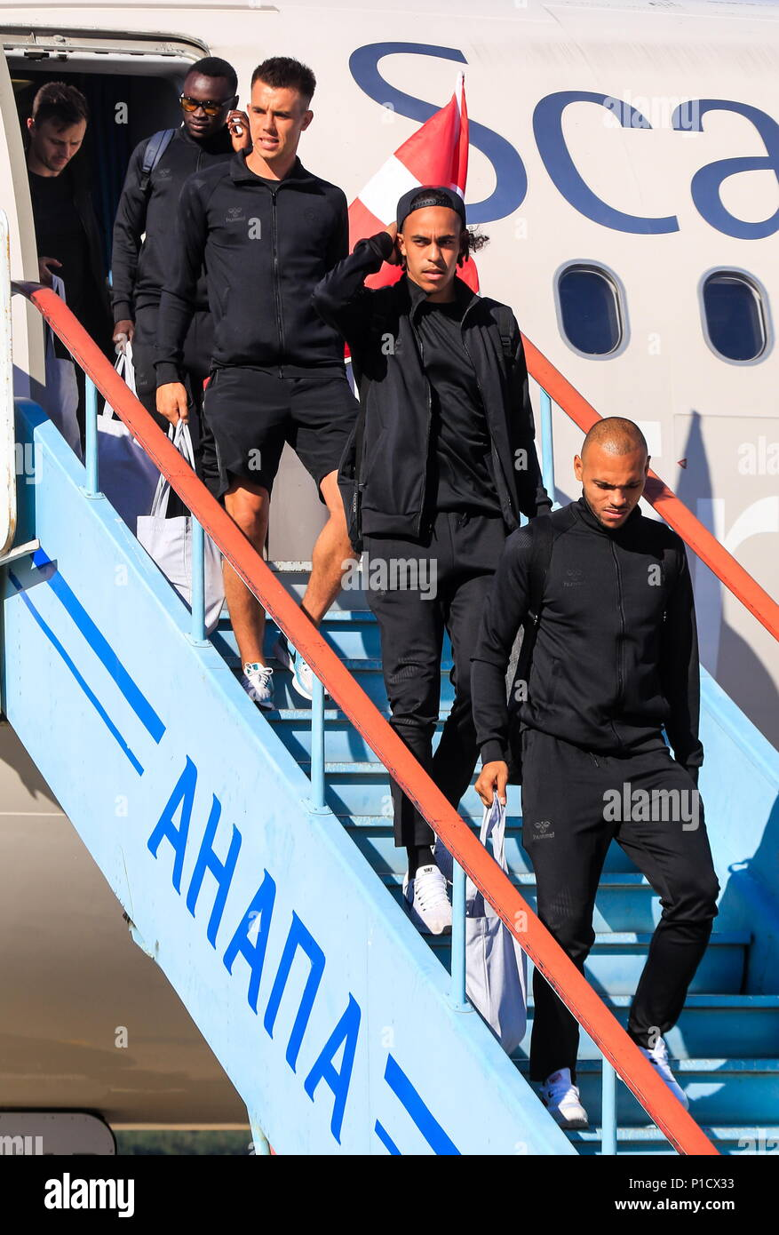 KRASNODAR TERRITORY, RUSSIA - JUNE 11, 2018: Pione Sisto, Jonas Knudsen, Yussuf Poulsen and Mathias Jorgensen (L-R) of the Danish national football team welcomed at Anapa Airport ahead of the 2018 FIFA World Cup scheduled to start on June 14. Valery Matytsin/TASS - Stock Image