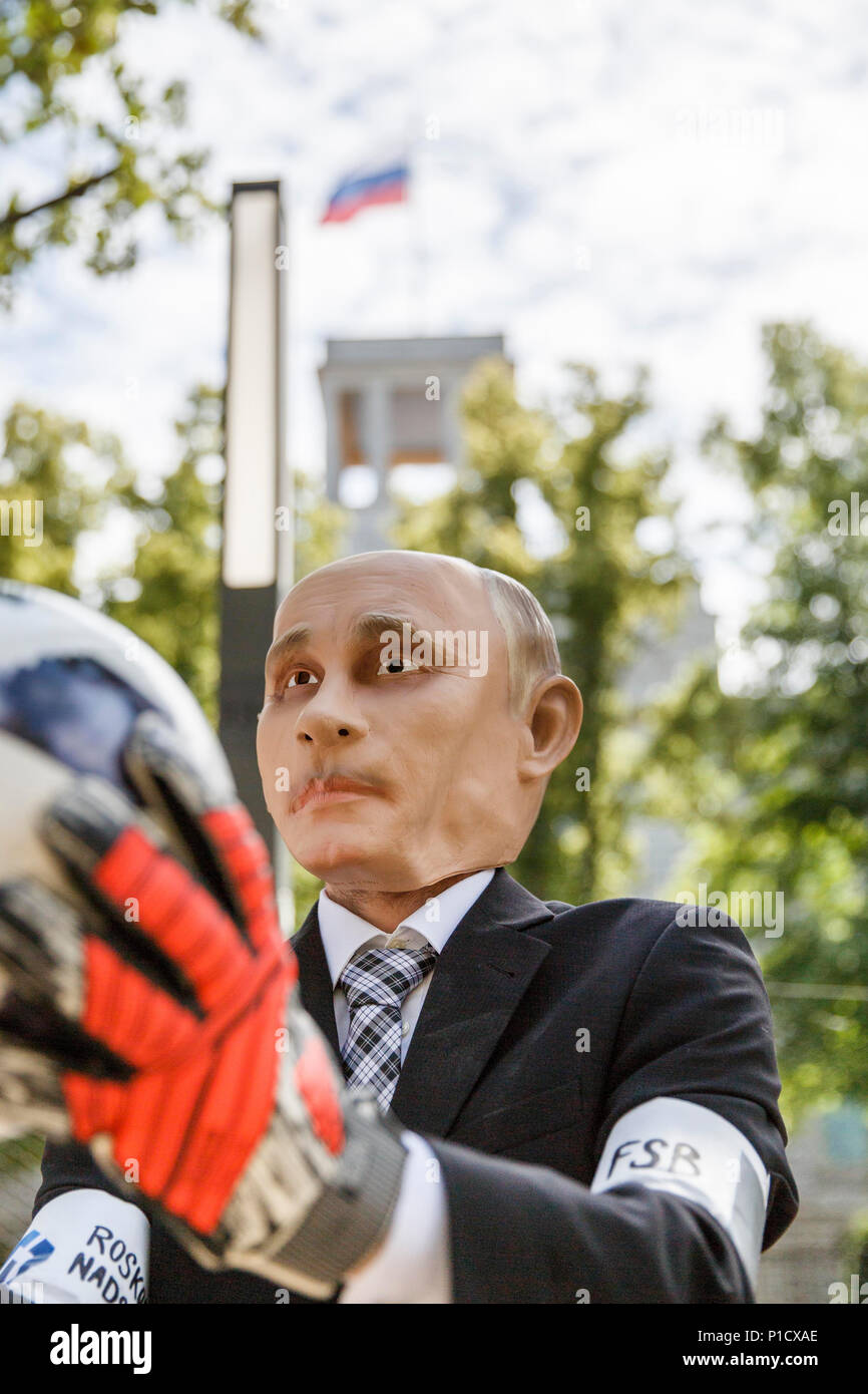 Germany Berlin An Activist Wearing A Mask With The Face Of The President Of Russia Putin Plays With A Soccer Ball During A Protest Campaign
