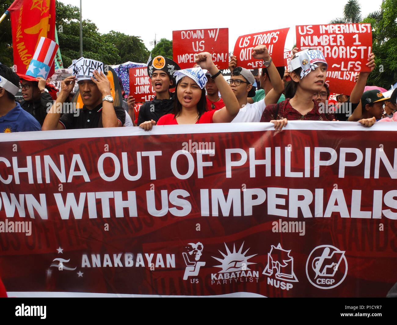 Manila, Philippines. 30th Jan, 2018. Militant students condemns US imperialism and Chinese incursions in the West Philippine Sea.While the Philippines celebrated it's 120th Independence Day, militant groups staged a protest at the US Embassy, slaming President Rodrigo Duterte's Policies and programs. They said that would only benefit US, China and other foreign corporations. Credit: Josefiel Rivera/SOPA Images/ZUMA Wire/Alamy Live News - Stock Image
