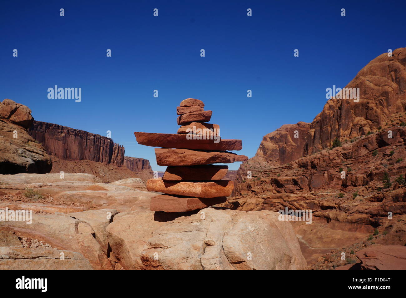 Cairns marking the trail ahead on the Syncline Loop Trail in Canyonlands National Park in Moab, Utah. - Stock Image