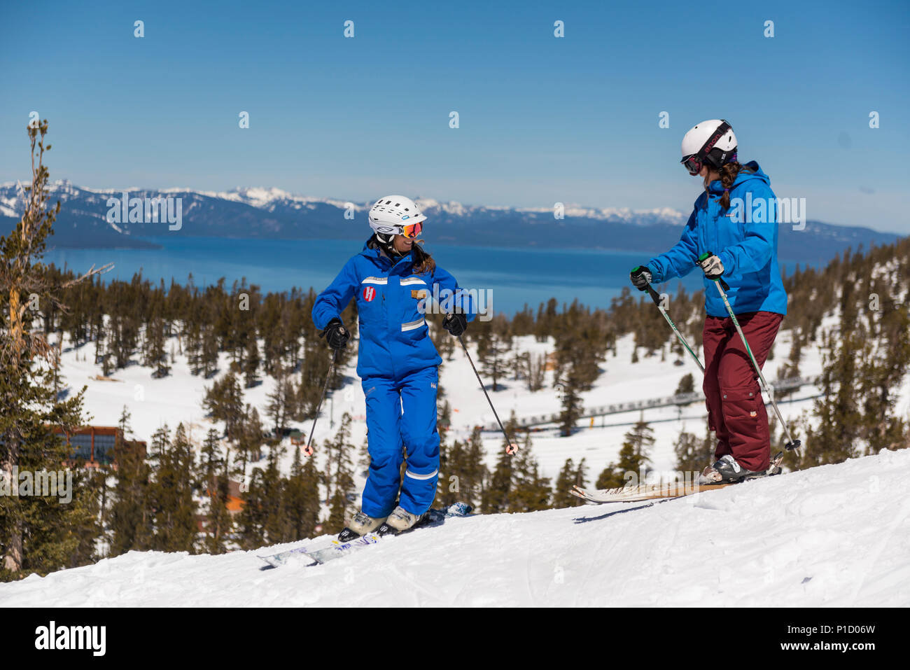 Heavenly ski instructor works with a student during a beginners lesson at Heavenly Valley Ski Area with Lake Tahoe in the background. Stock Photo