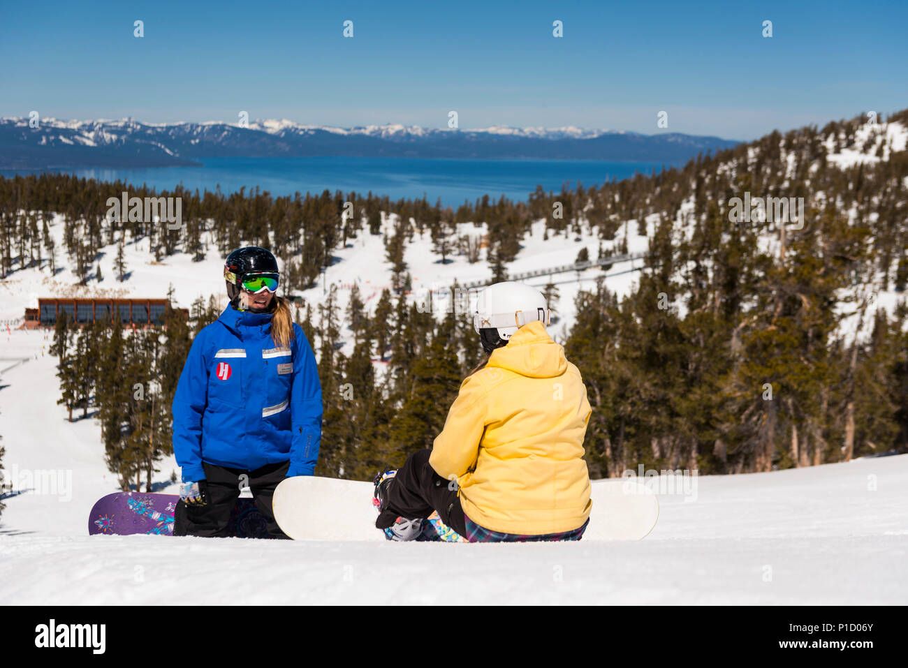 Heavenly Valley snowboarding school private lessons with lake tahoe view in south lake tahoe, California, North America Stock Photo