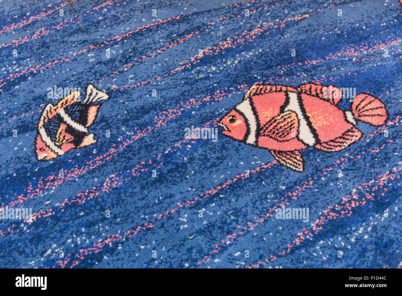 Fish designs on the carpet of the CAT ferry from Yarmouth, N.S. to Portland, Maine. - Stock Image