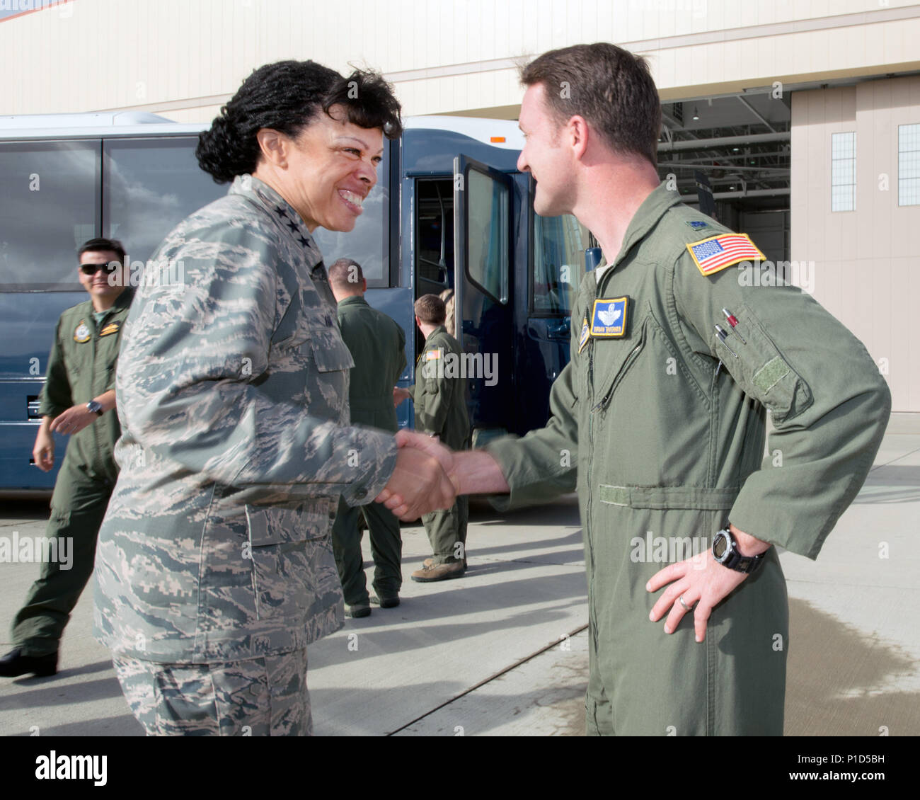 U.S. Air Force Lt. Gen. Stayce Harris, assitant Vice Chief of Staff and Director of the Air Staff, shakes hands with Lt. Col Brian Tavernier, 60th Operations Group deputy commander during her tour at Travis Air Force Base, Calif., Oct. 17, 2016. Harris also toured a KC-10 Extender, C-17 Globemaster III, and a C-5M Super Galaxy as part of the Air Force Vice Chief of Staff Air Attaché' Fall Tour (U.S. Air Force photo by Louis Briscese) - Stock Image