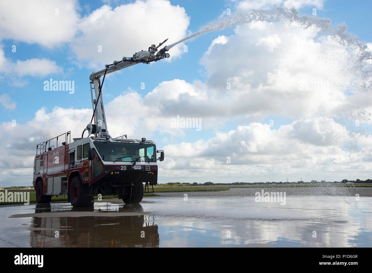 A member of the Joint Base San Antonio-Randolph Fire Department showcases the Oshkosh Striker 3000 to visitors during the JBSA Fire Prevention Week open house at JBSA-Randolph Oct. 15, 2016. The Oshkosh Striker 3000 is an Aircraft Rescue and Firefighting vehicle that can expend thousands of gallons of foam to extinguish jet fuel fires. Stock Photo