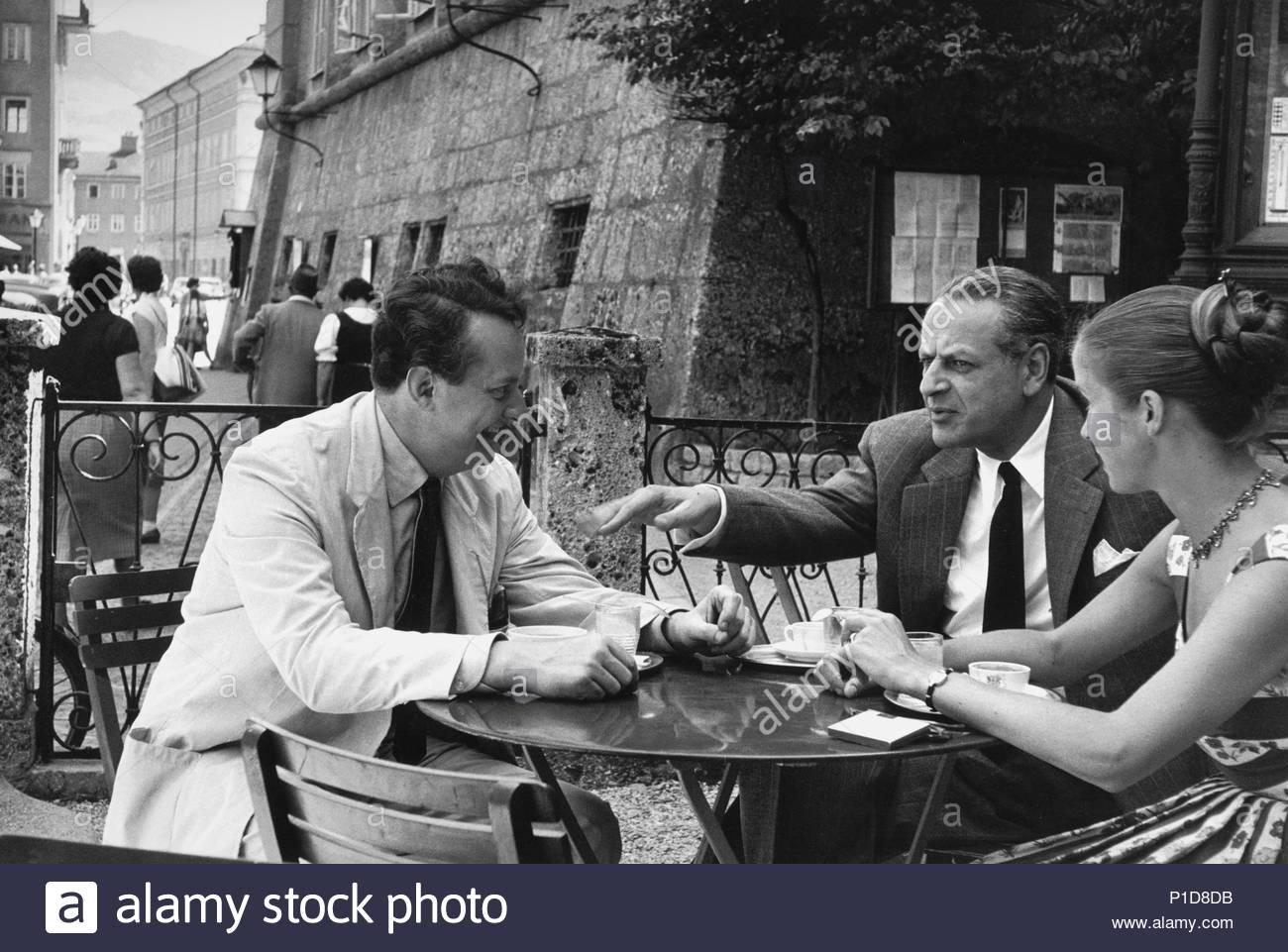 Composer Gottfried von Einem,his wife Lianne and   composer Rolf Liebermann,later director of the   Paris Opera Garnier,in the Cafe Tomaselli during the   Salzburg Festival 1956. Location: Townscape, Salzburg, Austria. - Stock Image