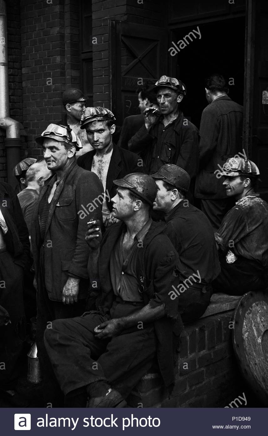 A monthly meeting at the Hlubina mine in Ostrava, Czechoslovakia's coal pot.Production and the next month's work-plan are discussed.During question time after the meeting, workers could lodge complaints. Hlubina,Czechoslovakia,1956. Location: Hlubina mine, Ostrava, Czech Republic. - Stock Image