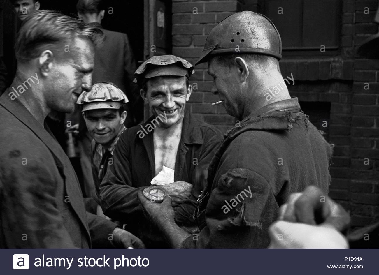 A monthly meeting at the Hlubina mine in Ostrava, Czechoslovakia's coal pot.Production and the next month's work-plan are discussed.During question time after the meeting, workers could lodge complaints. Hlubina,Czechoslovakia,1956. Author: Erich Lessing (b. 1923). Location: Hlubina mine, Ostrava, Czech Republic. - Stock Image