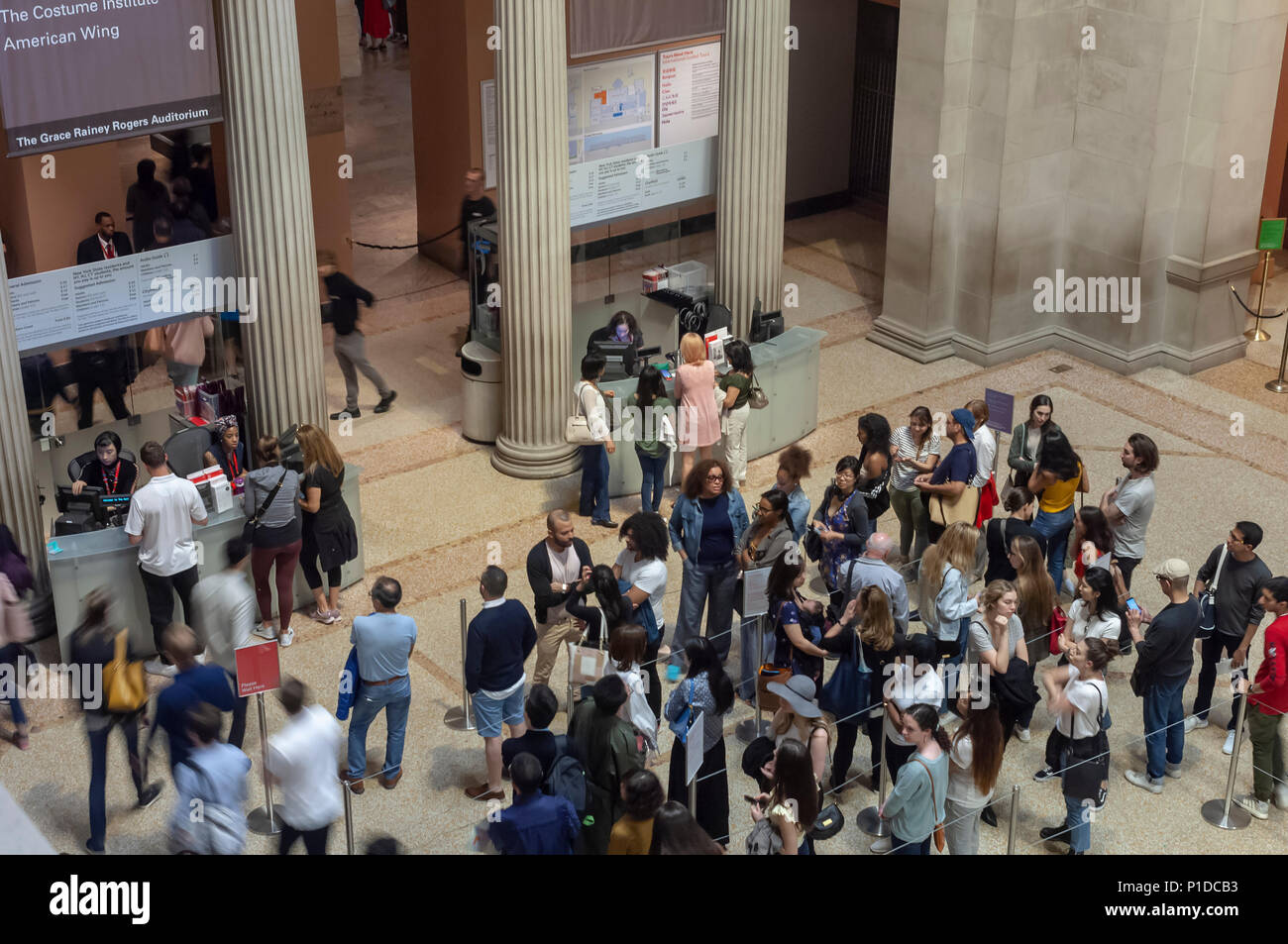 Visitors on line to pay admission to the Metropolitan Museum of Art in New York on Monday, May 28, 2018. Earlier this year the museum started a two tier admission program with New York City and tri-state residents participating in a pay-what-you-want scheme and tourists paying the full fare. (© Richard B. Levine) - Stock Image