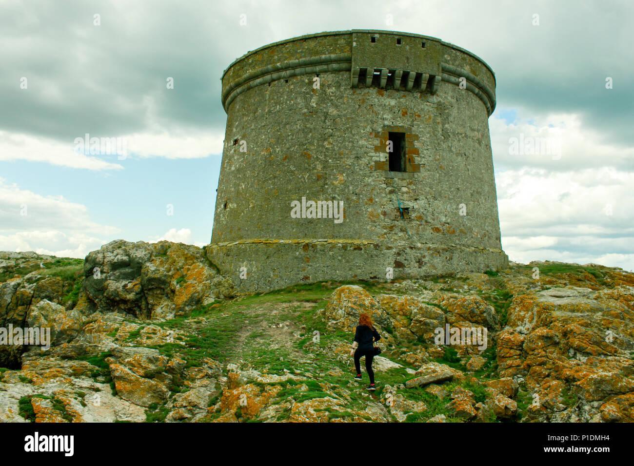Martello tower on Ireland's Eye off the coast of Howth, Co. Dublin - Stock Image