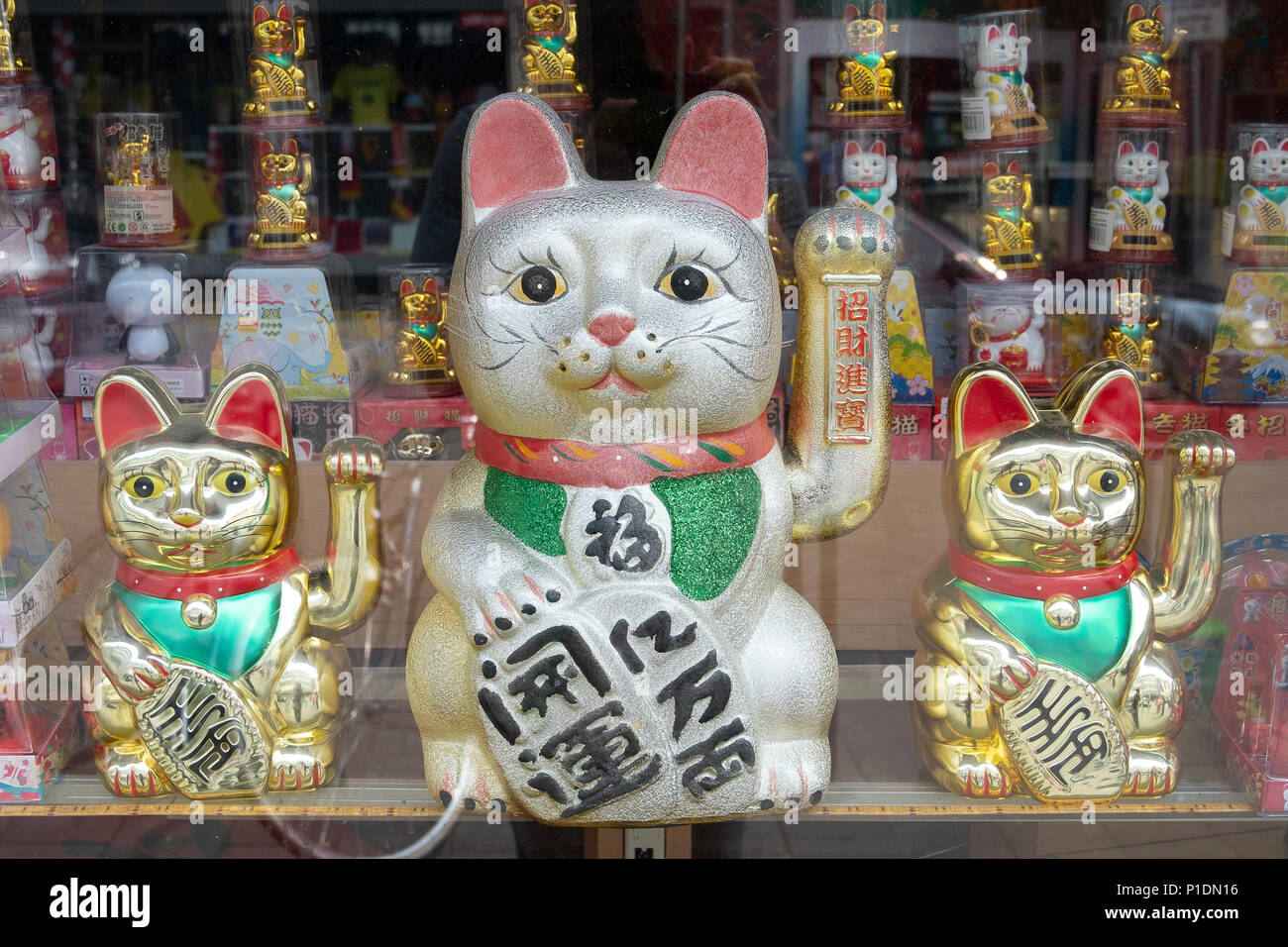 Manekinekos in a Chines shop in Cologne - Stock Image