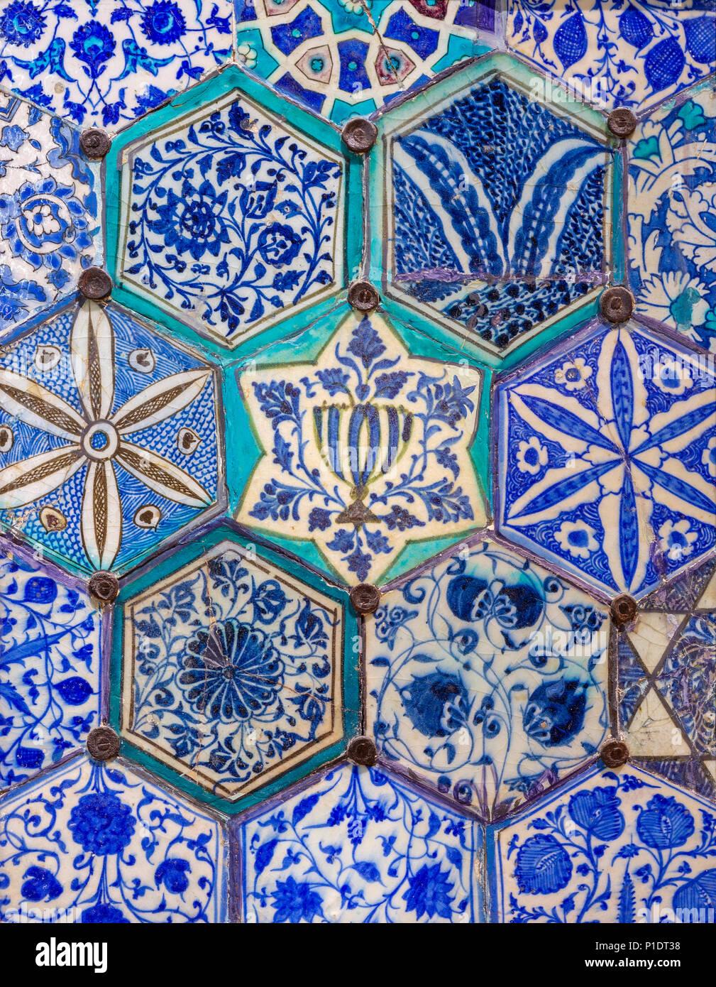 Mamluk era glazed ceramic tiles decorated with floral ornamentations, Public fountain of Qaitbay, Cairo, Egypt - Stock Image
