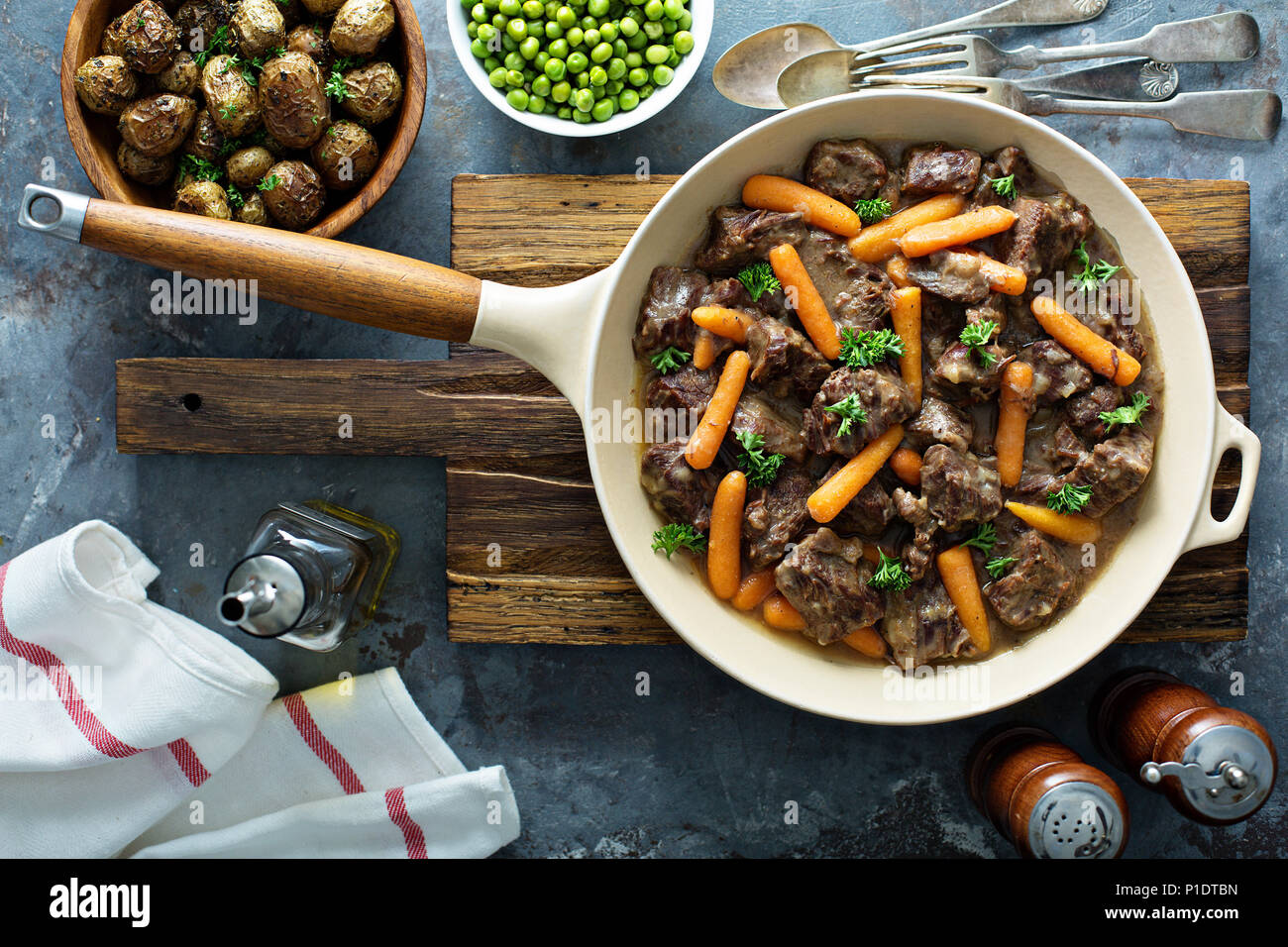 Beef stew with carrots and parsley - Stock Image