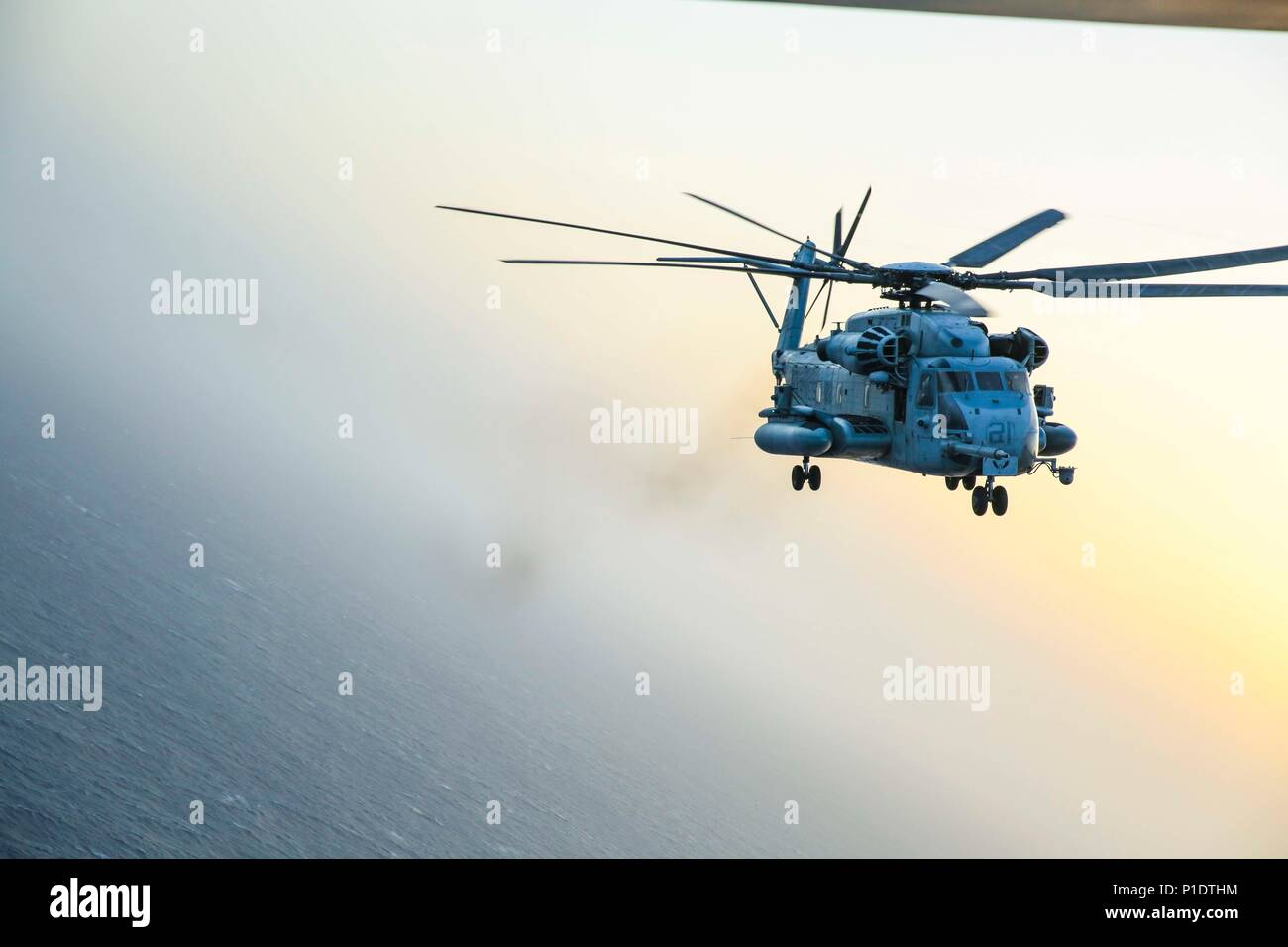 A U.S. Marine Corps CH-53E Super Stallion with Marine Medium Tiltrotor Squadron (VMM) 162 (Reinforced) flies in formation with an MV-22B Osprey, June 10, 2018, in the U.S. 5th Fleet Area of Operations. The 26th MEU and Iwo Jima amphibious ready group are deployed to the U.S. 5th Fleet of operations in support of maritime security operations to reassure allies and partners and preserve the freedom of navigation and the free flow of commerce in the region. (U.S. Marine Corps photo by Capt. Natalie B. Poggemeyer/Released) Stock Photo