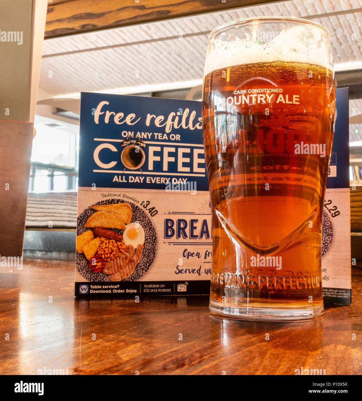 A pint of craft beer in front of menu in JD Wetherspoon pub in England. UK - Stock Image