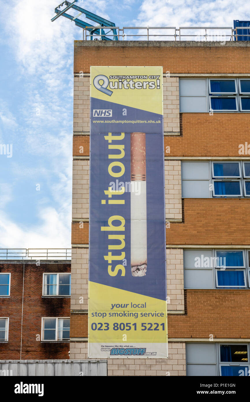 'Stub it out' Banner for the local NHS 'Quitters stop smoking service' along a building at the General Hospital in Southampton, England, UK - Stock Image