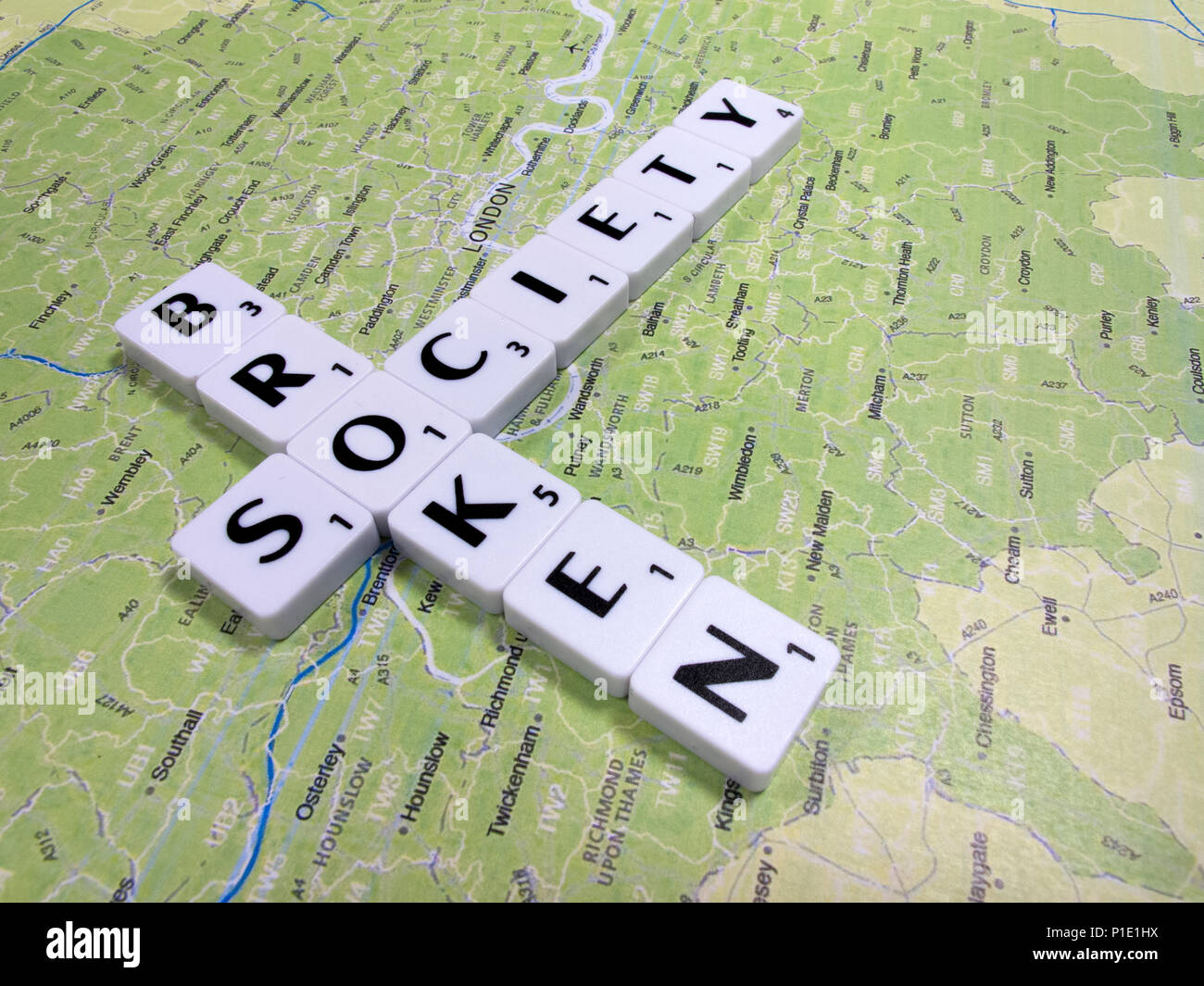 representation of broken society, a perceived or apparent general decline in moral values, with London map background - Stock Image
