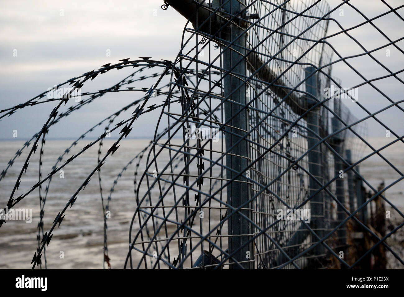 Razor wire fence on the edge of an army firing range Stock Photo ...