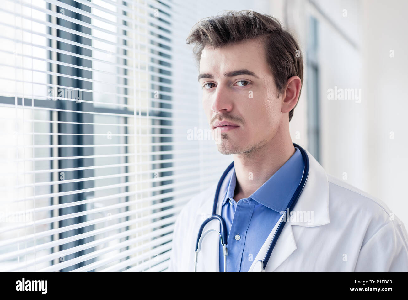 Portrait of a young serious doctor looking at camera with determination Stock Photo