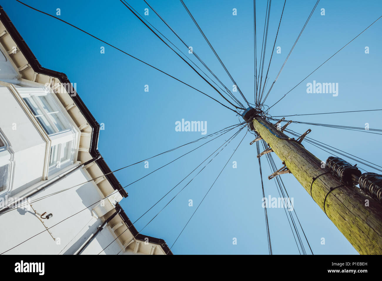 Power Pole with Cobweb Powerlines, Brighton, England - Stock Image