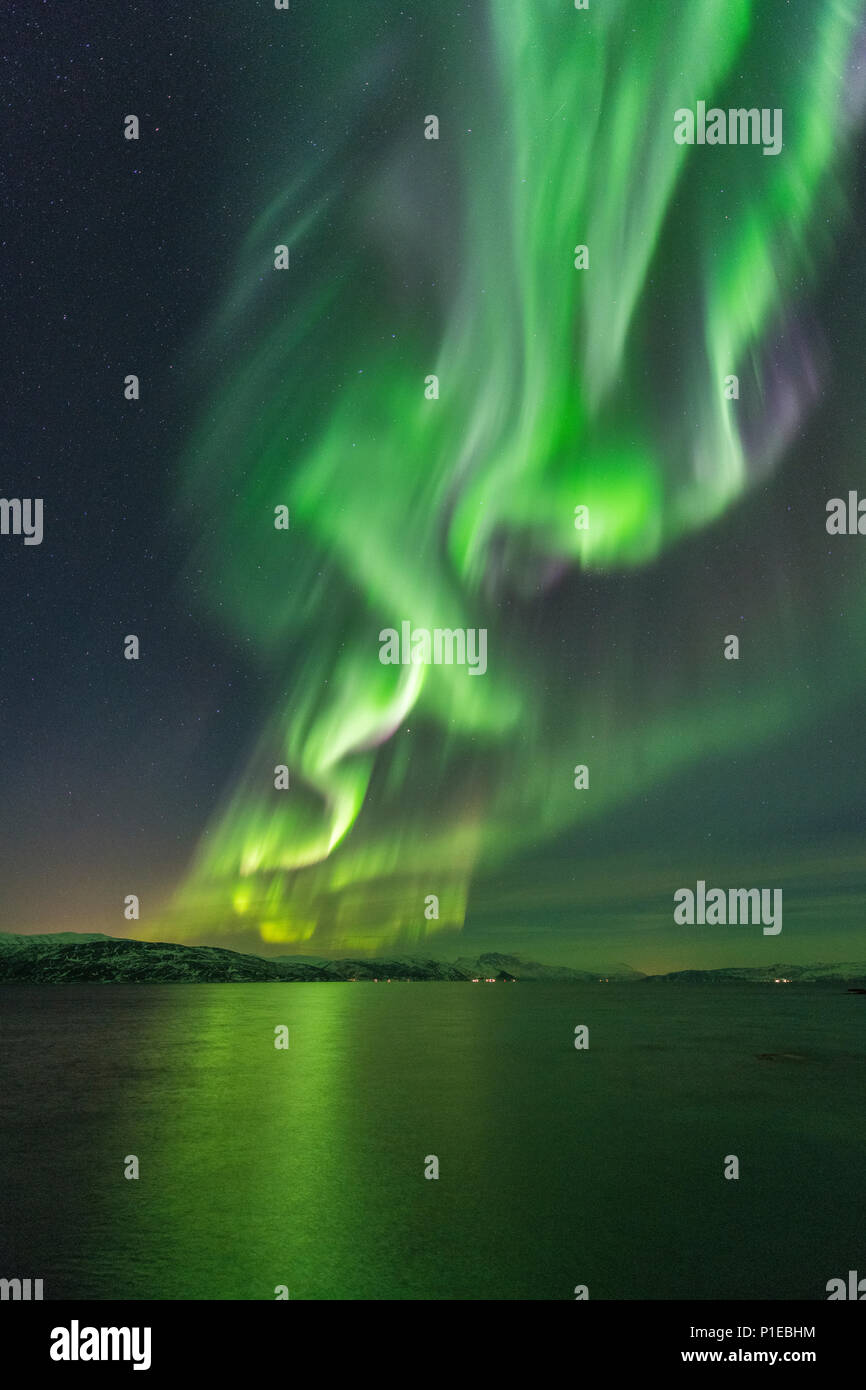 Northern lights over the Stønesbotn at night, Senja, Norway - Stock Image