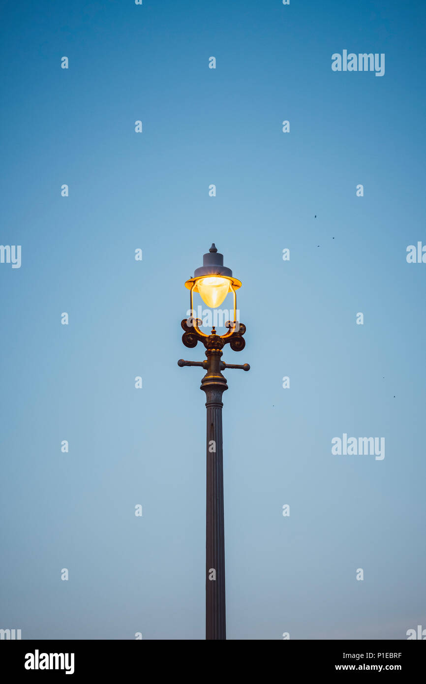 Old street lamp at dusk, Brighton, England - Stock Image