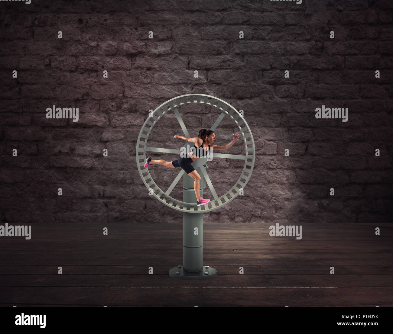 Athletic woman runs in a looping wheel. concept of sport routine - Stock Image