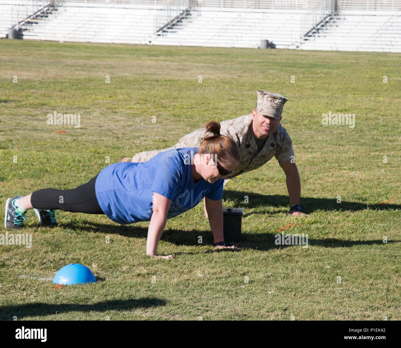 amanda roselli demonstrates perfect push up form as her husband