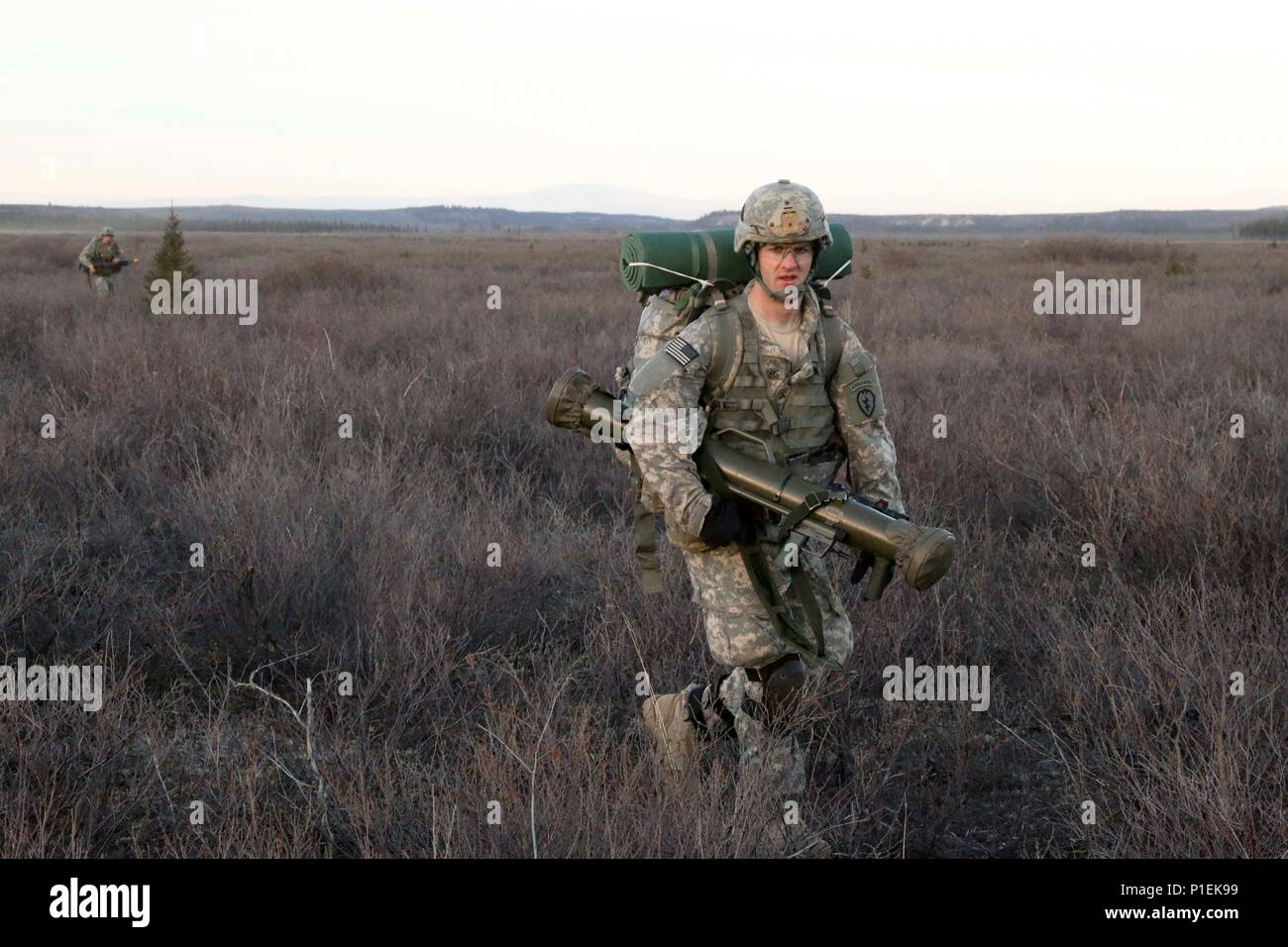 A Paratrooper With 1st Battalion 501st Parachute Infantry Regiment 4th Brigade Combat Team Airborne 25th Division Moves To An