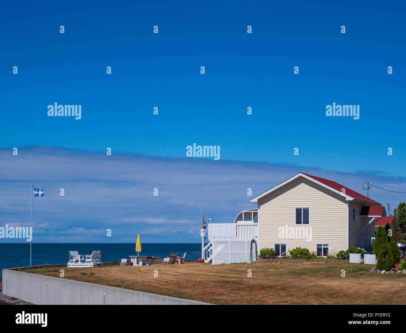 Home beside the Gulf of Saint Lawrence, Les Mechins, Gaspe Peninsula, Quebec, Canada. - Stock Image