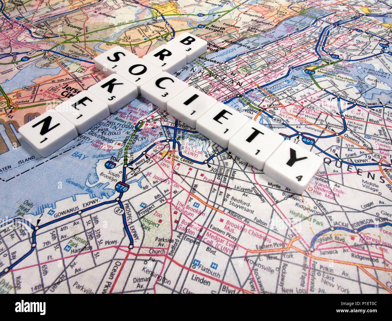 representation of broken society, a perceived or apparent general decline in moral values, with New York map background - Stock Image