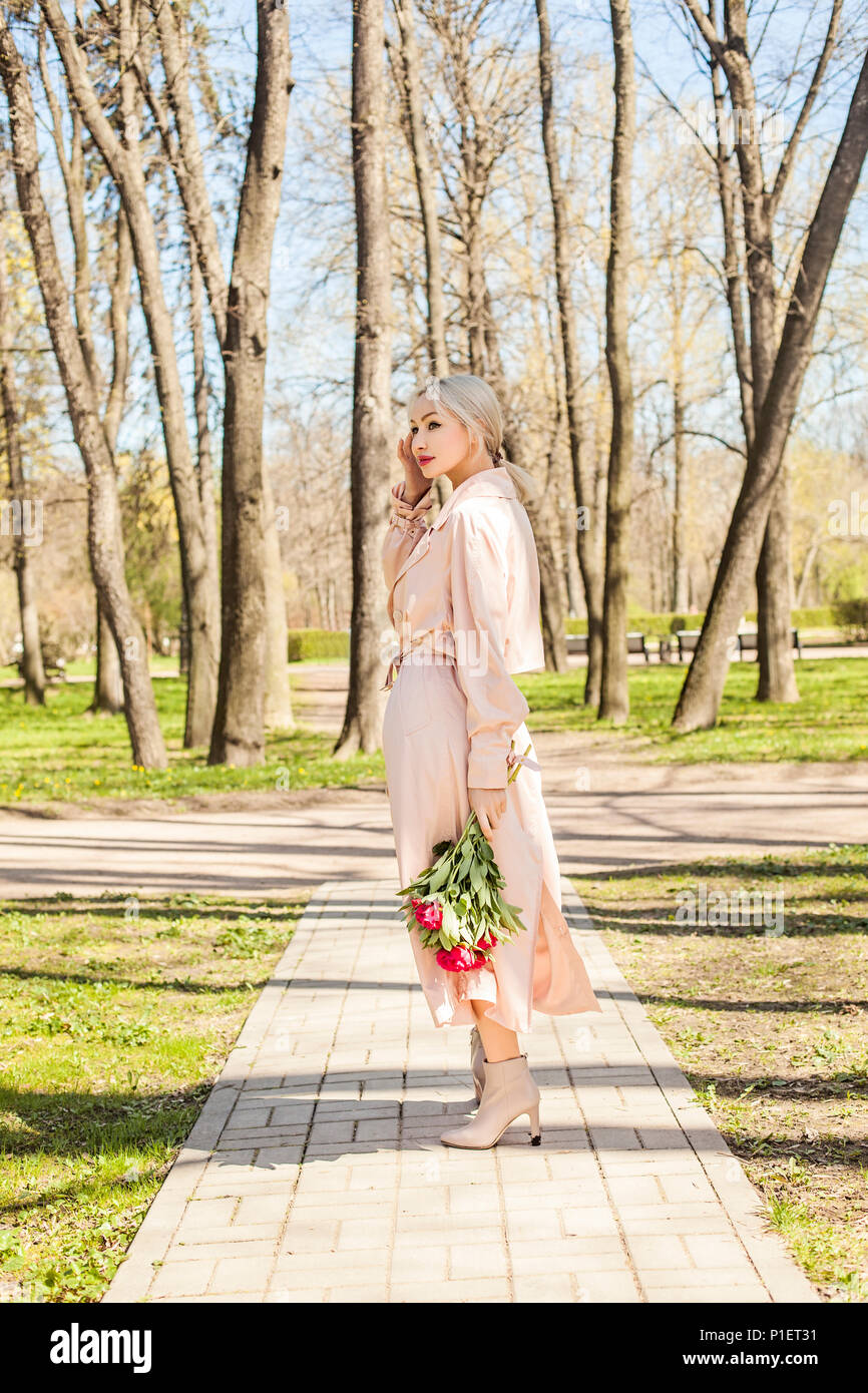 Fashion Portrait Of Happy Beautiful Woman With Flowers Outdoors