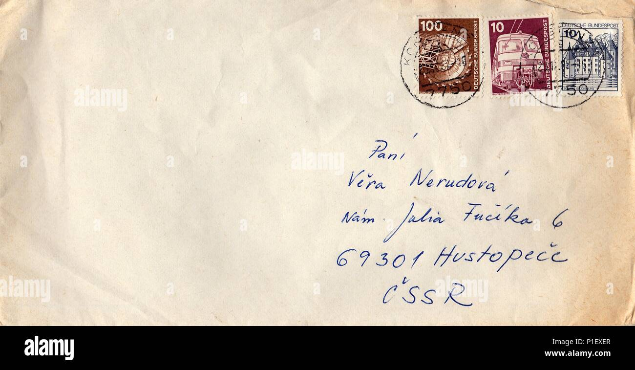 GERMANY - CIRCA 1980s: A vintage used envelope and stamps. Rich stain and paper details. Can be used as background. - Stock Image