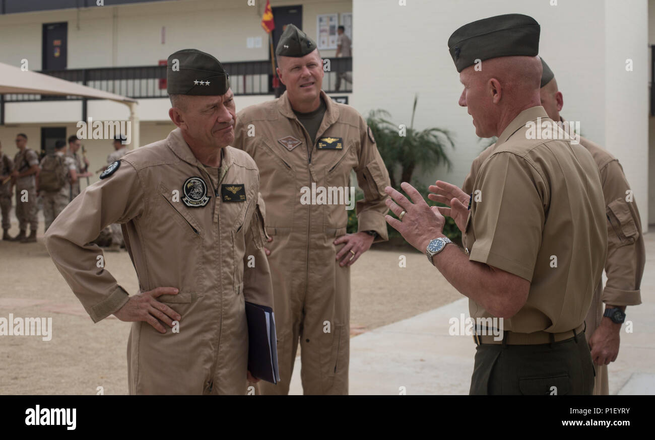 From left to right, U.S. Marine Corps Lt. Gen. Jon Davis, deputy commandant for aviation, Maj. Gen. Mark Wise, 3rd Marine Aircraft Wing (MAW) commanding general, are greeted by Col. Richard Fuerst, commanding officer of Marine Corps Air Station (MCAS) Iwakuni, Japan, at MCAS Yuma, Ariz. Oct. 24, 2016. This event gave Yoshihiko Fukuda, mayor of Iwakuni City, Japan, an idea of what to expect of the aircraft following the scheduled basing of Marine Fighter Attack Squadron (VMFA) 121 at MCAS Iwakuni. After its transition, VMFA-121 will be the first F-35B squadron stationed in Japan.(U.S. Marine Co Stock Photo