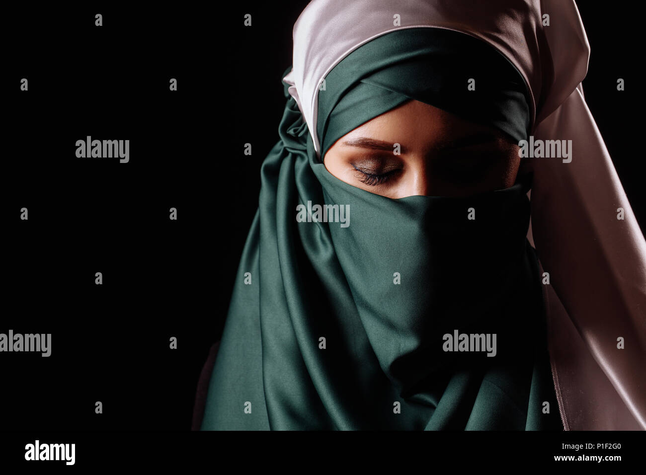 upset beautiful Muslim lady in hijab. obedient wife - Stock Image