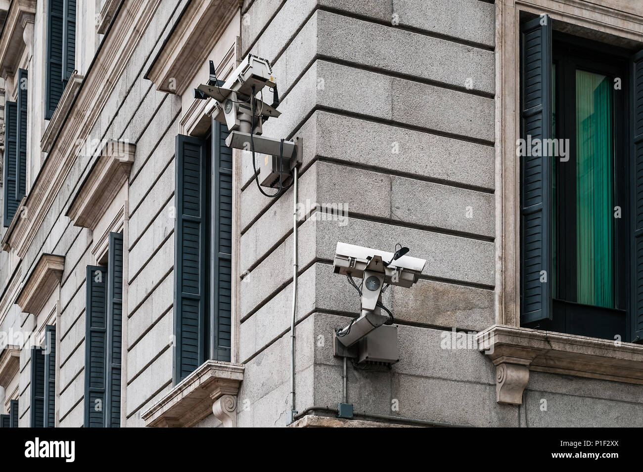 Security video cameras mounted on building exterior, Madrid, Spain. - Stock Image
