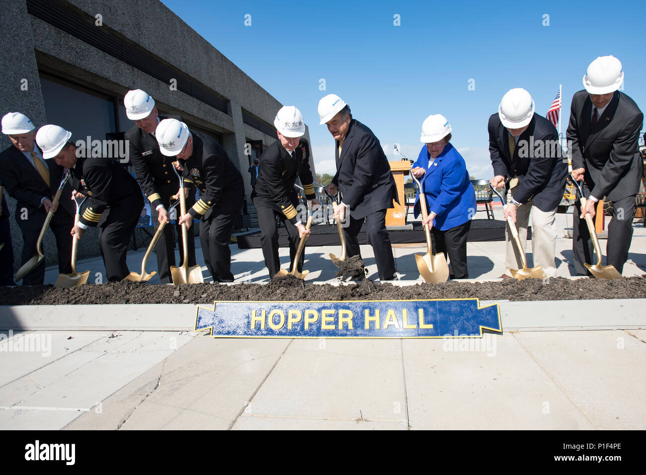 161021-N-DY073-080  ANNAPOLIS, Md. (Oct. 21, 2016) The official part The official party of the Hopper Hall ground breaking ceremony at the United States Naval Academy (USNA) dig out a scoop of dirt. Hopper Hall, which will house USNA's Center for Cyber Studies, is the namesake of Rear Adm. Grace Hopper who is often referred to as 'The Mother of Computing'. (U.S. Navy photo by Petty Officer 3rd Class Brianna Jones/Released) - Stock Image
