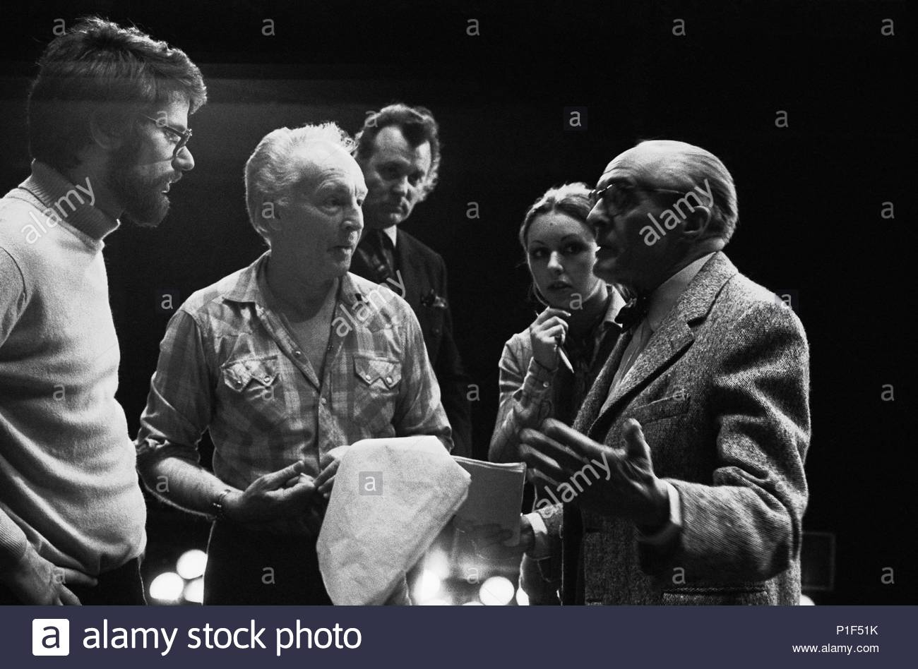 Director Rene Clair (right) talking to choreographer Georges Balanchine (center with open shirt) and Michael Dietmann,assistant to Rolf Liebermann. Location: Opera House Palais Garnier, Paris, France. - Stock Image
