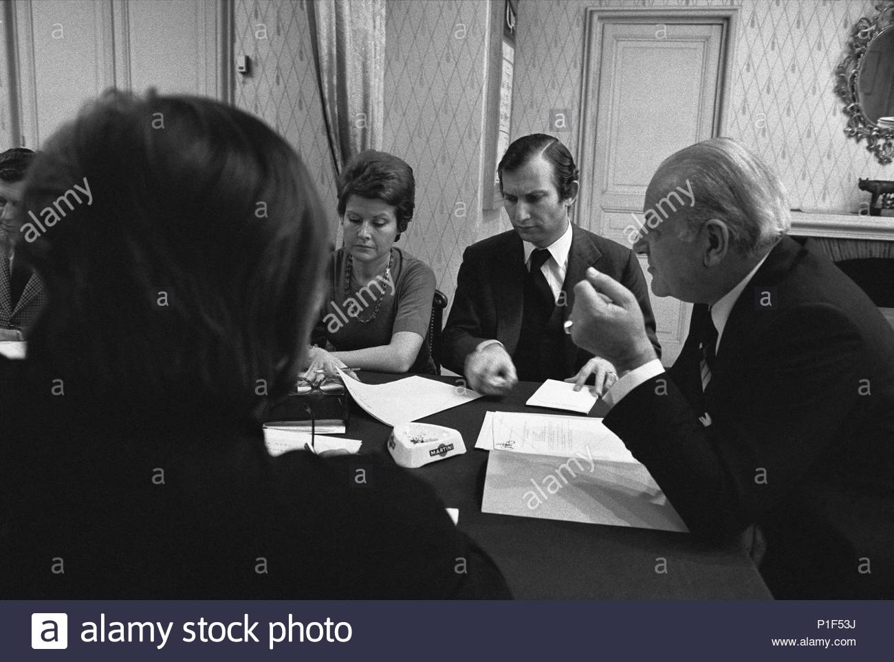 Composer Rolf Liebermann,director of the Paris Opera,   meeting with his staff. left of Liebermann is Hugue Gall,   his assistant. Location: Opera House Palais Garnier, Paris, France. - Stock Image