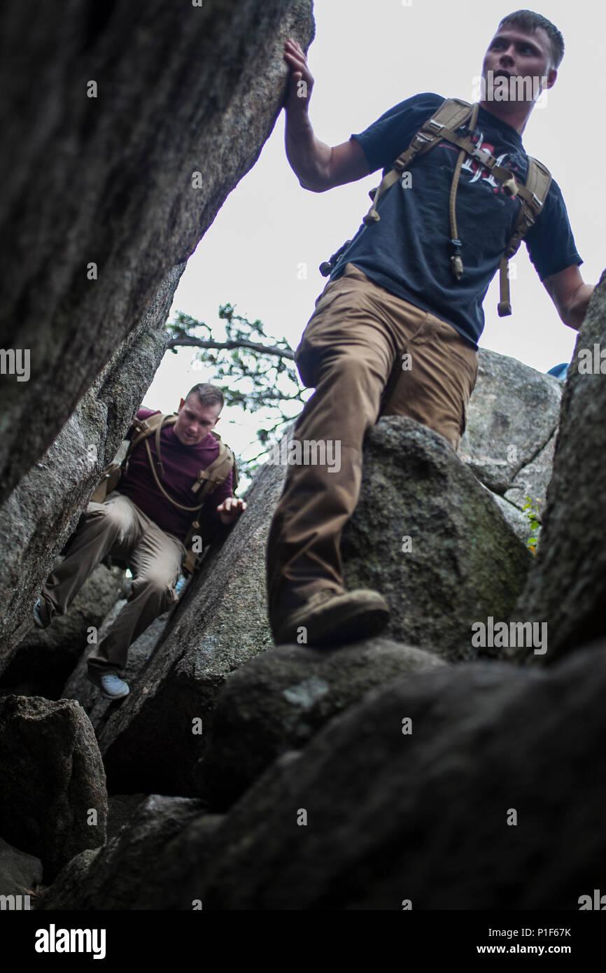 A U S Marine With The Basic School Climbs Through A Rock