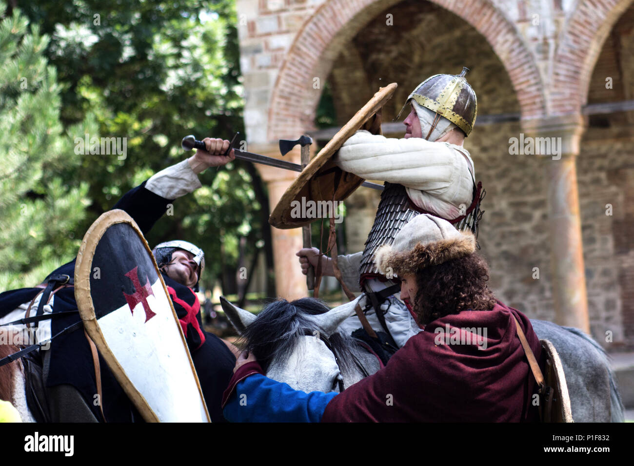 Nis, Serbia - June 10, 2018: Medieval knight battle on horse with swords and armor. Middle ages fight concept Stock Photo