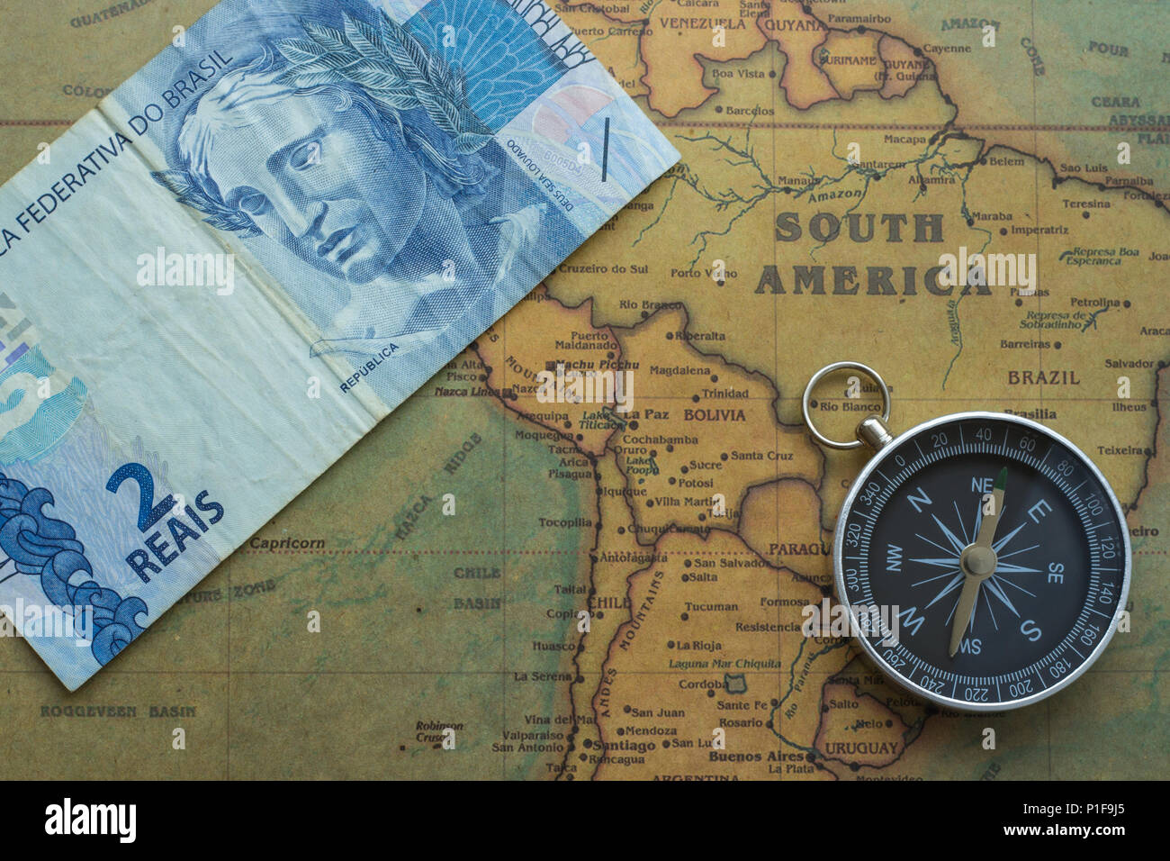 Compass Money Map old map of south america with brazil money and compass, close up  Compass Money Map
