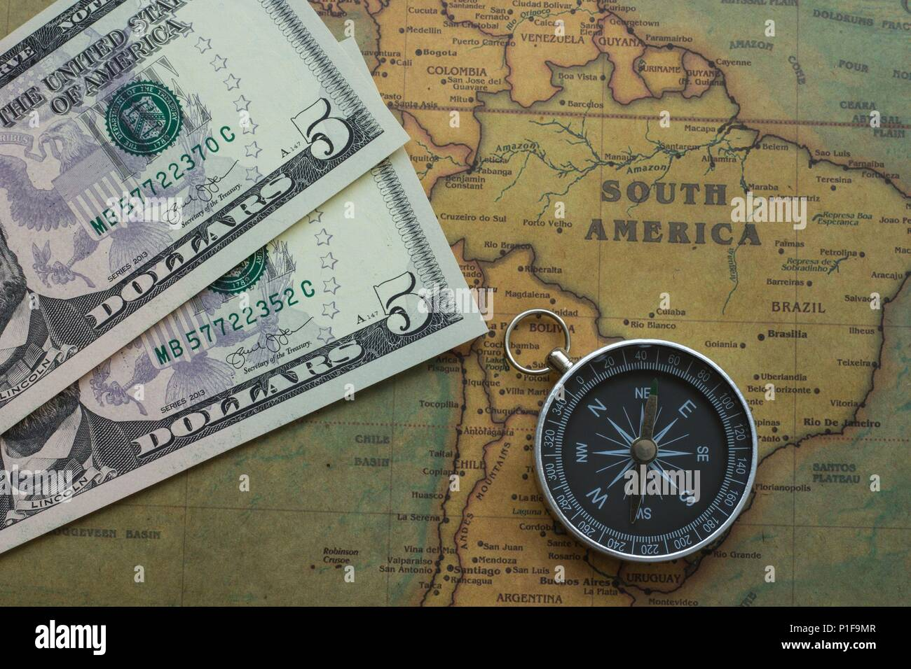 America Map With Compass.Ancient Map Of South America With Usa Money And A Compass Close Up