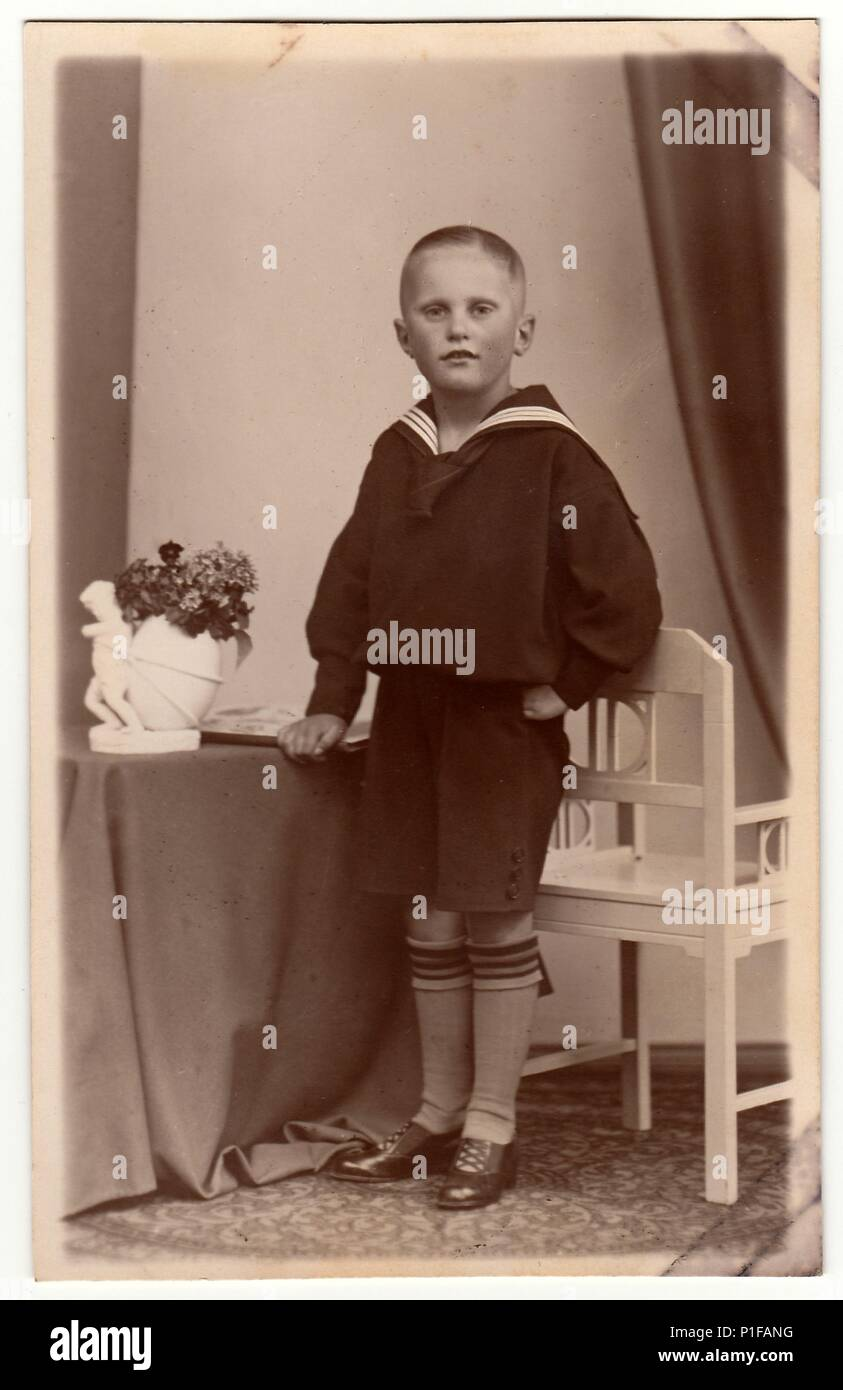 LEIPZIG GERMANY - CIRCA 1930s Vintage photo shows a young boy wears sailor costume. Black u0026 white antique studio portrait.  sc 1 st  Alamy & LEIPZIG GERMANY - CIRCA 1930s: Vintage photo shows a young boy ...