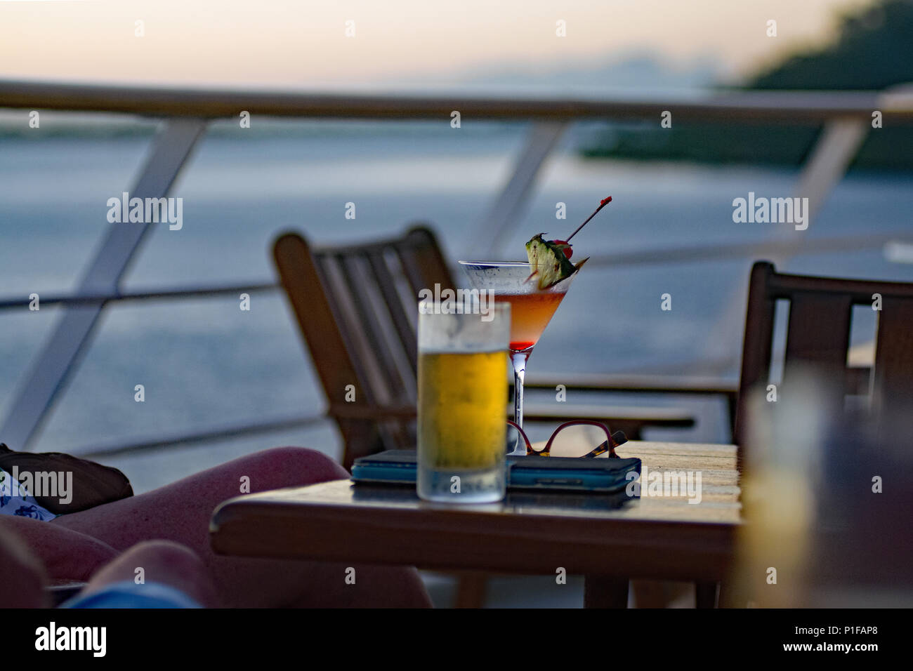 Back lit cocktails on the table at the stern deck. - Stock Image