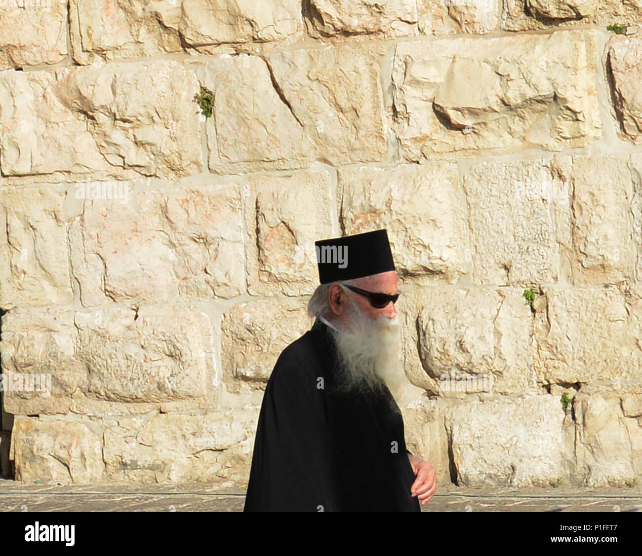 A Russian Orthodox priest in the old city of Jerusalem. - Stock Image