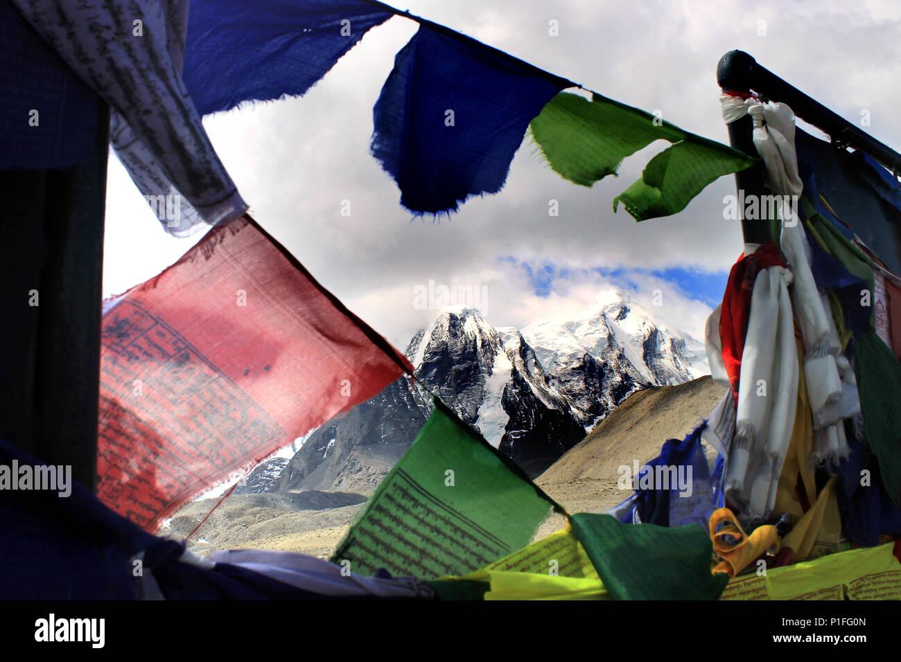 Sikh praying flags besides the Gurudongmar Lake. On the way to Gurudongmar lake. Stock Photo